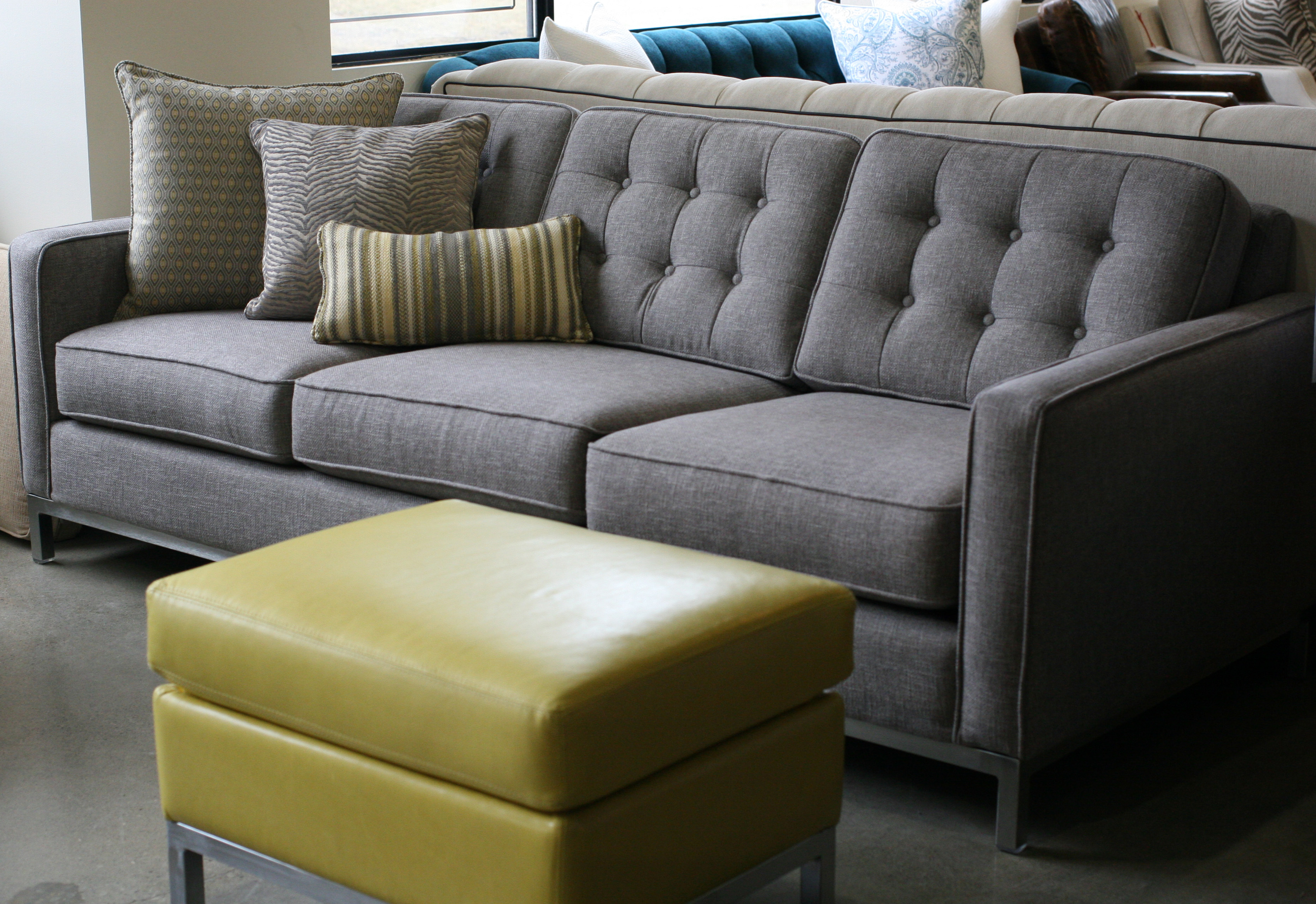 adab1517ec6 Condo-size tufted Josh sofa with accent pillows and citron leather ottoman.  Josh sofa w ottoman